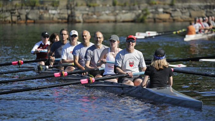 Eight boats filled with alumni, most veterans of MIT Crew, take to the Charles River for Reunion Row, a Tech Reunions tradition in its third decade.