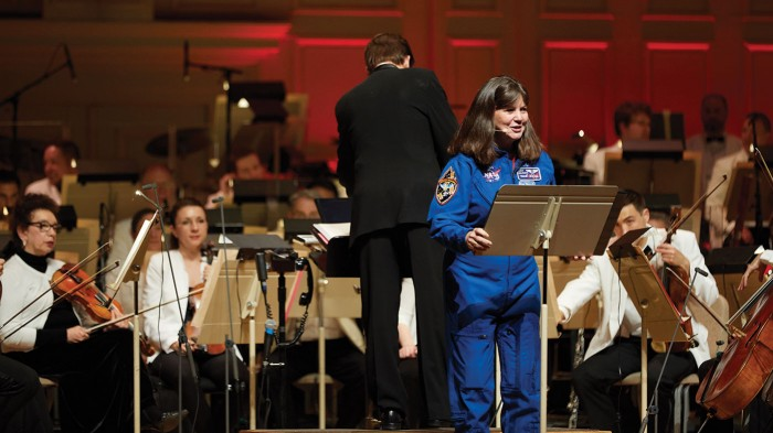 Retired astronaut Cady Coleman '83 narrates a special performance of the new musical work From the Earth to the Moon and Beyond for an all-MIT Symphony Hall crowd at Tech Night at Pops.