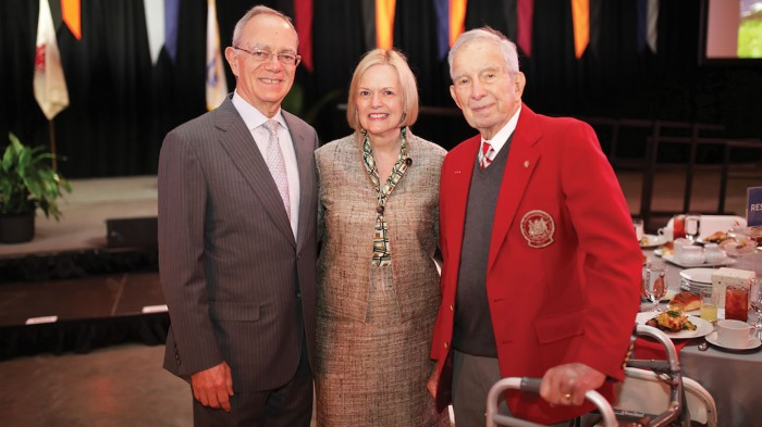 Following the Tech Day program, alumni gather to celebrate class giving. There to represent the 75th-reunion class is Edwin G. Roos '44 (pictured with President L. Rafael Reif and his wife, Christine).