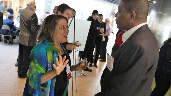 Classmates catch up at the 40th-reunion dinner in the Brain and Cognitive Sciences building. Pictured: Lisa Egbounu-Davis '79 and Burtel Batson '79, SM '80.