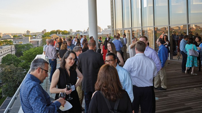On the top floor of the MIT Media Lab, the Class of 1994 celebrates its quarter-century reunion against sunset-lit views of Boston and Cambridge.