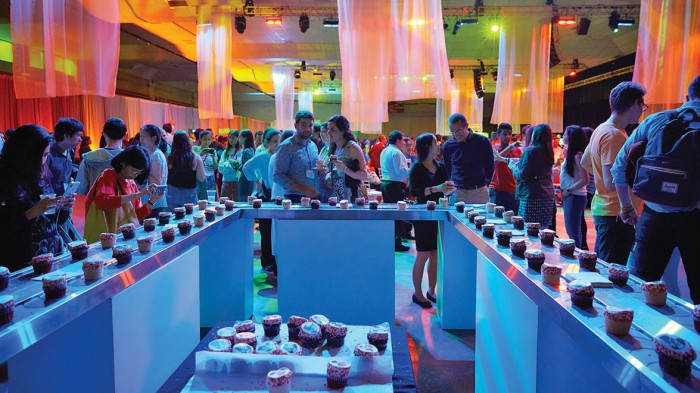 At Toast to Tech, partiers take a break from dancing to the live band in Johnson Athletic Center and grab a treat from the cupcake conveyor belt.