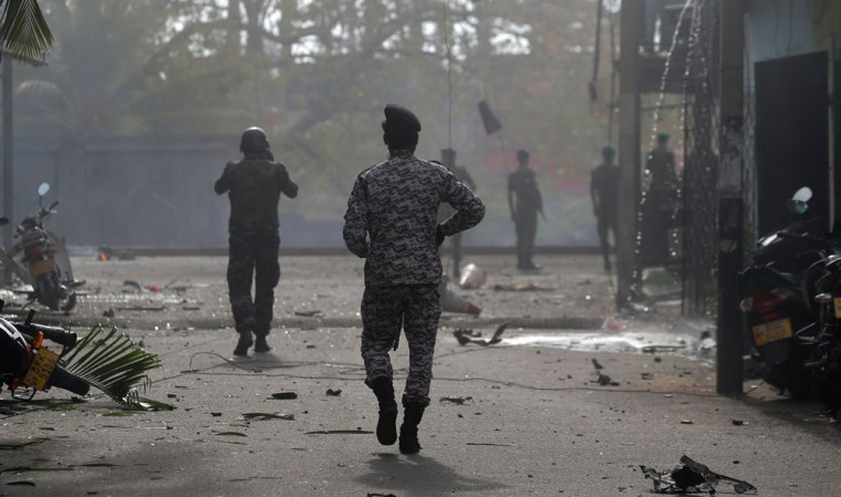 Sri Lankan security forces approaching a bombing site in Colombo, the country's capital