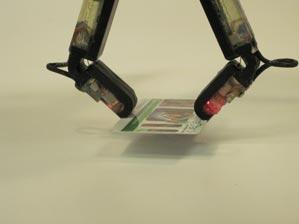 three-fingered hand made by iRobot