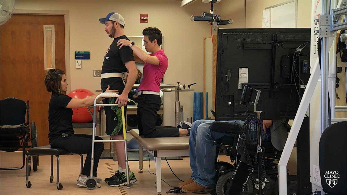 Paralysed man stands in rehab center