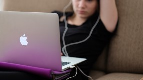 image of teen young woman girl using computer and phone apple imac