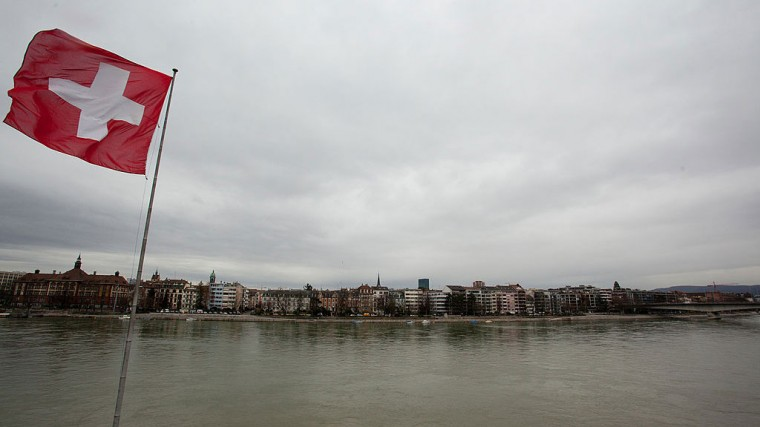 An image of the Swiss flag flying in Basel
