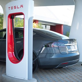 tesla at a charging station