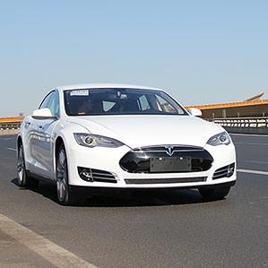 white Tesla on the road