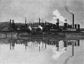 B&W photo of factories and smoke stacks