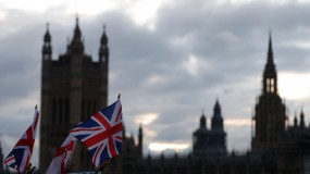 UK flags fly in front of the British Parliament