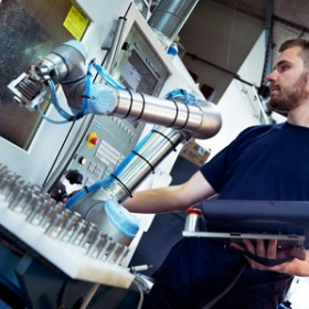 robot arm with man in periphery