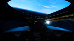 Image taken out the window of Virgin Galactic's spacecraft of Earth..