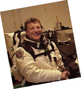 Photo of man in astronaut suit