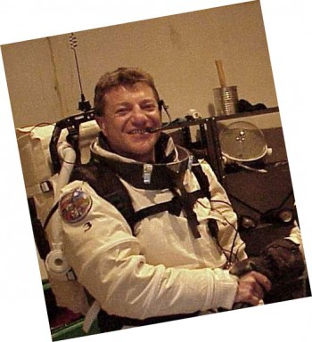 Photo of man in astronaut suit