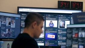 "A man sits in front of monitors in Facebook's election ""war room"""