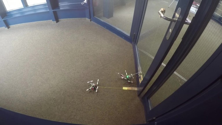 Two wasp drones team up to open a door