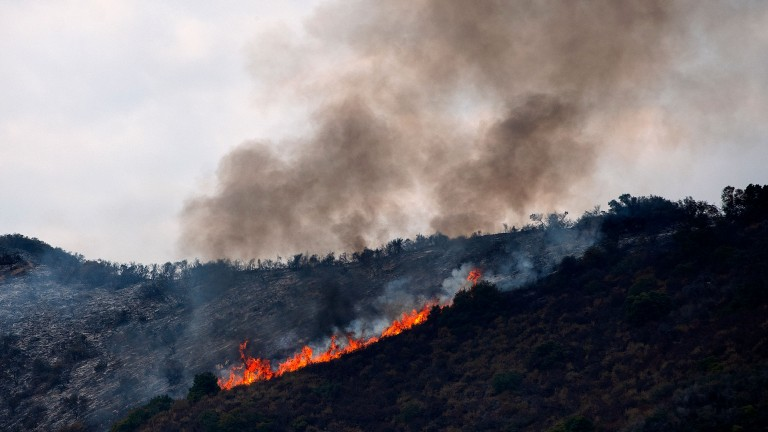 A wildfire burns near Murrieta, California