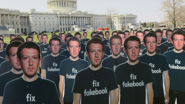 cut outs of zuckerberg in front of congress