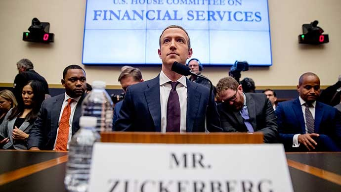 Facebook CEO Mark Zuckerberg sits in front of the House Committee on Financial Services